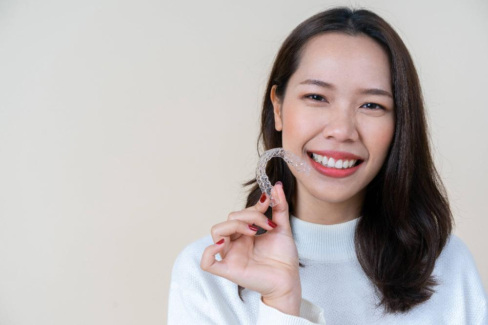 Woman holding Invisalign in Seattle, WA | 98103 Dentist