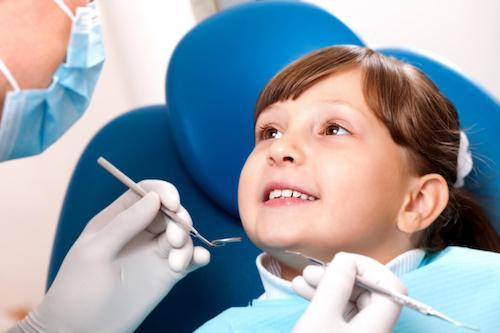Young child in dentist chair | Family Dentist Seattle, WA