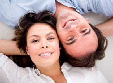 Man and woman laying together | Sedation Dentist Seattle, WA