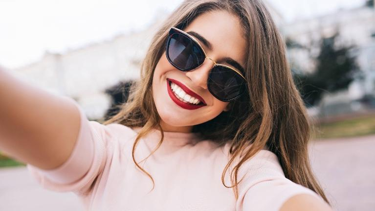 woman with red lipstick smiling l dentist seattle wa